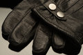 Deluxe leather black calf skin gentlemen s gloves on a glass surface Royalty Free Stock Photo