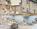Demolish demolition machine pulls down buildings flats and shops at canada square corby northants england on may the buildings Stock Photos