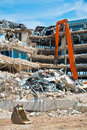 Demolished buildings pieces of metal and stone are crumbling from Stock Photo