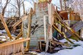 Demolished wooden structure in a forest area in winter Royalty Free Stock Photo