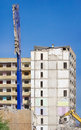 Demolition of a block of high rise building pitted facade highrise Stock Photos