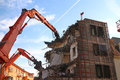 Demolition of building structure with heavy machines Stock Photos