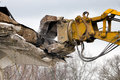 Demolition crane dismantling a building Royalty Free Stock Photo