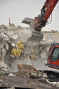 Demolition by Excavator Stock Photo