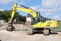 Demolition excavator at building site Stock Images