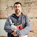 Demolition hammer man mason manual worker Stock Photography
