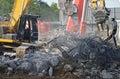 Demolition of highway bridge with construction equipment Stock Photography
