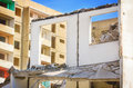 Demolition of houses slab construction in ruins pitted facade highrise Stock Photo