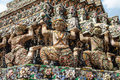 Demon guardian statues at wat arun temple in bangkok close up of decorating the buddhist thailand Stock Photo