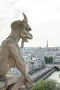 A demon like gargoyle on notre dame cathedral ii stone gargole statue the Stock Images