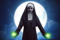 Demon nun asian woman get green spell strength Royalty Free Stock Photo