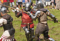 Demonstration of knights fighting in medieval costumes  in The castle Chudow Royalty Free Stock Photo