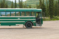 Denali tour bus green of tours alaska usa Stock Photography