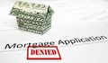 Denied mortgage app a application with an origami dollar house Royalty Free Stock Photo