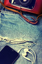 Denim background with smartphone,  camera Royalty Free Stock Photo
