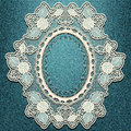 Denim blue background with the sewn lace frame. Royalty Free Stock Photo