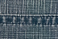 Denim fabric with a seam rough in the middle Stock Photo