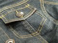 Denim jacket blue jeans detail Royalty Free Stock Photo