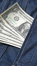Denim jeans with money in back pocket blue dollar notes Stock Image