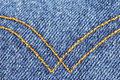 Denim material with curry seams Royalty Free Stock Photography