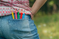 Denim pocket with colored pencils Royalty Free Stock Photo