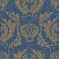 Denim seamless pattern with a gold Damascus print. Blue background with a large floral ornament.