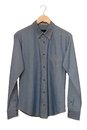 Denim shirt a blue is on clothes hanger Royalty Free Stock Image