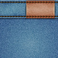 Denim texture with leather label Stock Photos