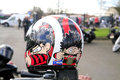 Dennis the menace a hells angel s safety helmet with graphics left on a parked motorcycle at a hells angel funeral Stock Images