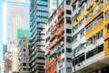 Dense Asian Residential High-Rise Architecture in Summers Day, Hong Kong Royalty Free Stock Photo