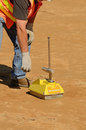 Density guage field engineer using a nuclear gauge to check for soil of a soil lift fill on a new commercial development Royalty Free Stock Image