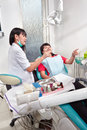 Denstist prep patient young female dentist pre her before examination Royalty Free Stock Images