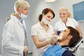 Dental assistant taking approbation test with two dentists Stock Photography