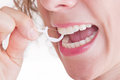 Dental care with dental floss woman about her teeth Royalty Free Stock Photos