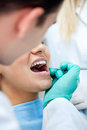 Dental care dentist checking patient s teeth concept Stock Images