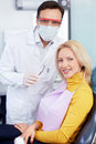 Dental doctor and patient in a clinic Royalty Free Stock Photos