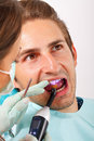 Dental filling the dentist is the patient s tooth Stock Photo