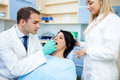 Dental office dentist examining woman's mouth in Royalty Free Stock Images