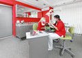 Dental office dentist and nurse at work in modern Royalty Free Stock Photos