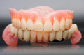 Dental prosthesis laboratory its reflection image Stock Photo