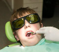 Dental treatment boy during in office Stock Photos