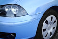 Dented car front wing closeup of a light blue of small Royalty Free Stock Photo