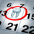 Dentist appointment and dental check up health care concept as a month calendar with a tooth circled and highlighted as a reminder Stock Photography
