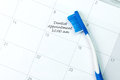 Dentist appointment reminder blue toothbrush on on a calendar Royalty Free Stock Photography