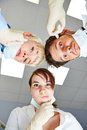 Dentist and dental assistants looking pensive at patient pov Stock Photography