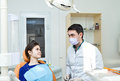 Dentist in a dental clinic the girl on reception at the dentist s chair examining patients teeth dentists admission to office Royalty Free Stock Photography