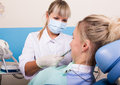 Dentist examines the oral cavity on tooth decay. Royalty Free Stock Photo