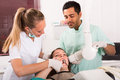 Dentist examines patient at clinic Royalty Free Stock Photo