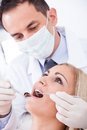 Dentist examining patient male female in clinic Royalty Free Stock Photos