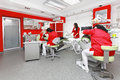 Dentist office dentists at work in modern red dental Royalty Free Stock Photo